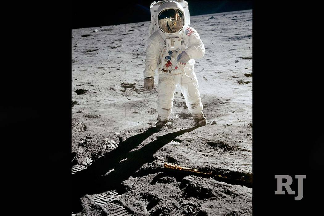 In this 1969 photo released by NASA, astronaut Buzz Aldrin walks on the surface of the moon near the leg of the lunar module Eagle during the Apollo 11 mission. Astronaut Neil Armstrong, who took  ...