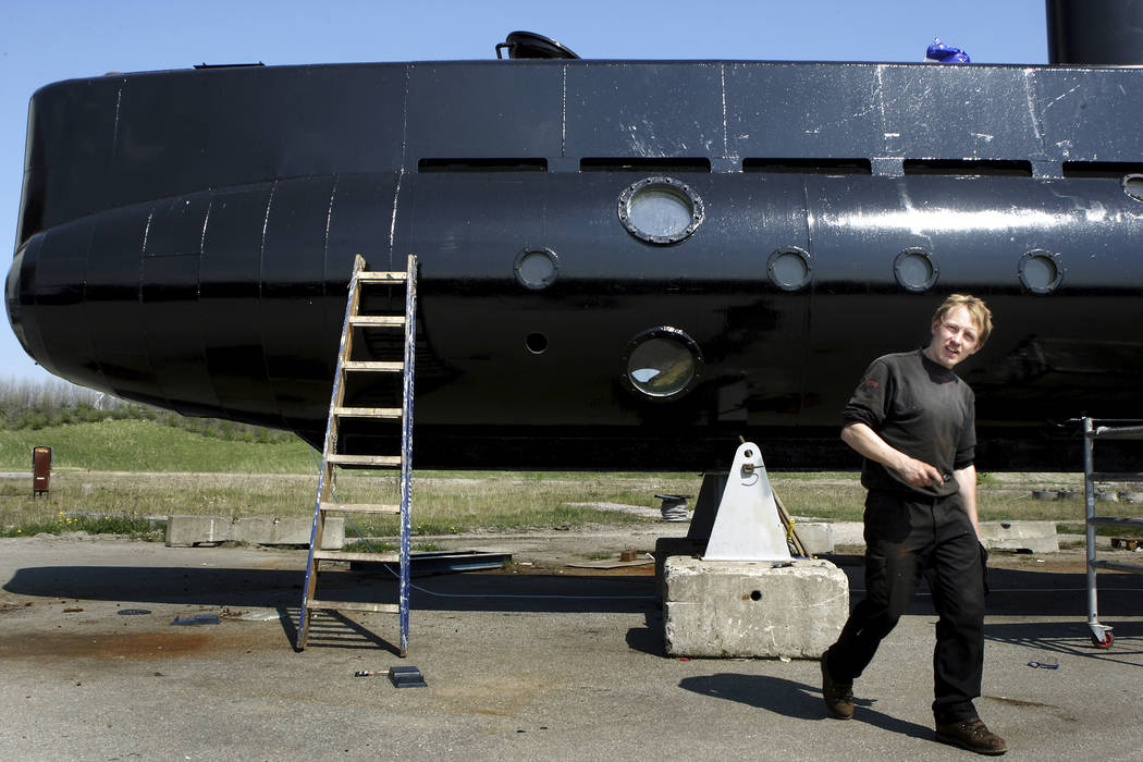 This April 30, 2008 file photo, shows a submarine and its owner Peter Madsen. Danish police confirmed Wednesday Aug. 23, 2017, a headless torso found on a beach off Copenhagen has been identified  ...
