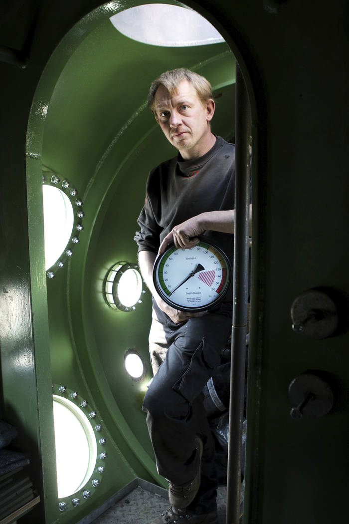 In this April 30, 2008 file photo, submarine owner Peter Madsen stands inside the vessel. Danish police confirmed Wednesday Aug. 23, 2017, a headless torso found on a beach off Copenhagen has been ...