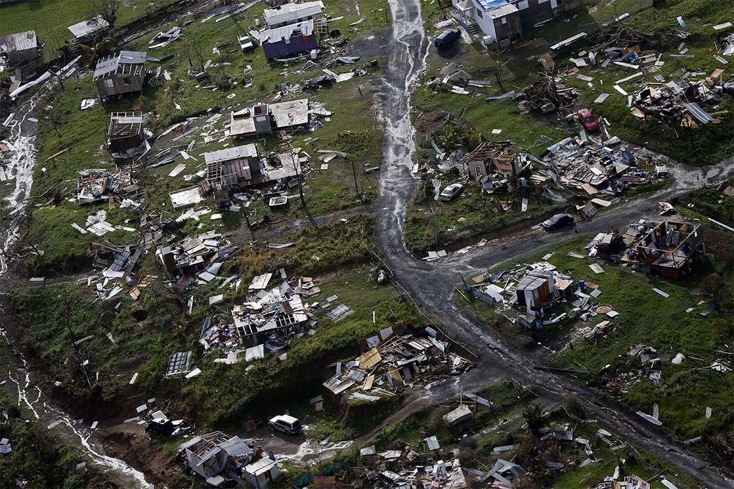 Destroyed communities are seen in the aftermath of Hurricane Maria in Toa Alta, Puerto Rico. The House is on track to backing President Donald Trump's request for billions more in disaster aid, $1 ...