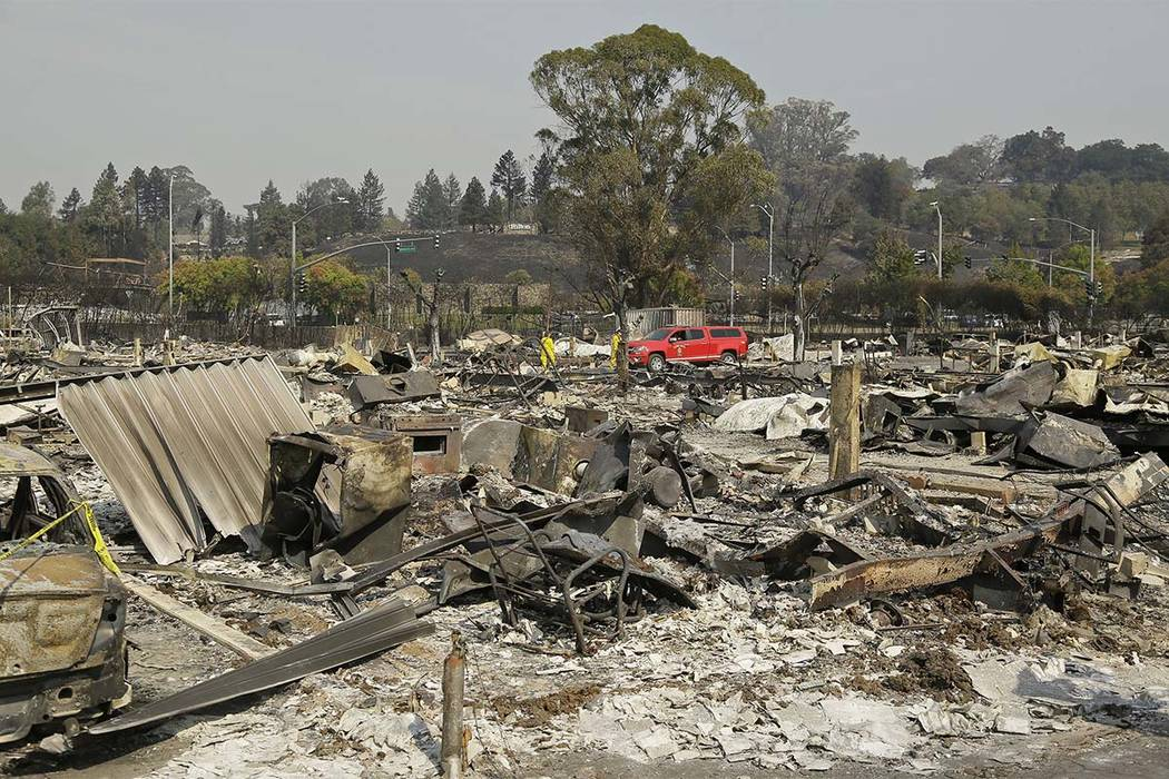 Shown are the remains of where Linda Tunis lived at the Journey's End mobile home park Wednesday, Oct. 11, 2017, in Santa Rosa, Calif. Tunis's remains were found in the rubble, ending a search in  ...
