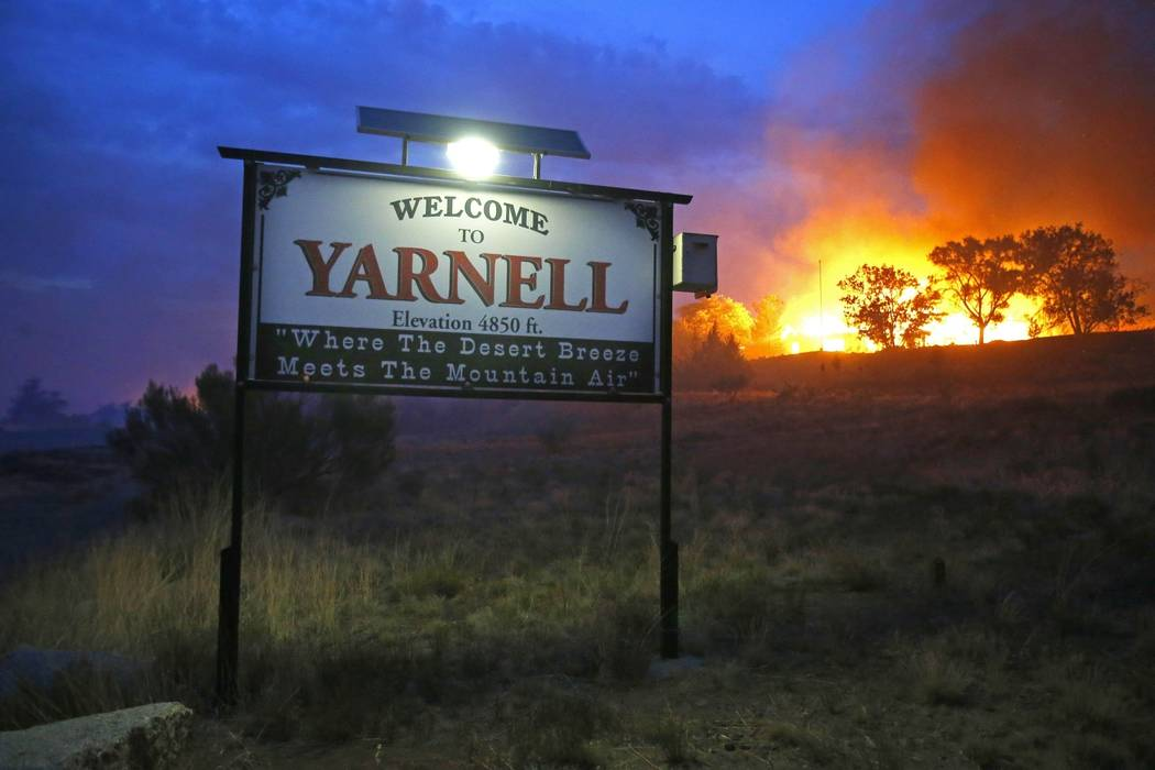 """FILE - In this June 30, 2013 file photo, a wildfire burns homes in Yarnell, Ariz. The movie, """"Only The Brave"""", that chronicles the 2013 Yarnell wildfire that killed 19 Arizona fi ..."""