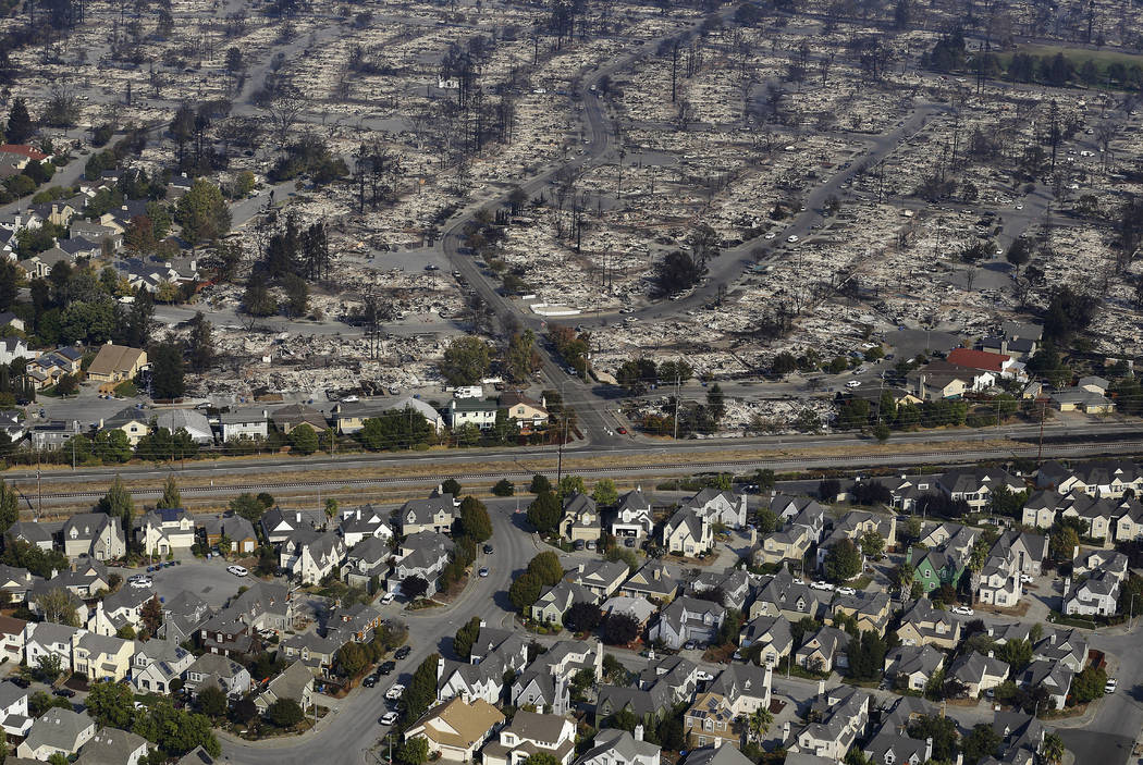 Homes destroyed from fires are seen from an aerial view in Santa Rosa, Calif., Wednesday, Oct. 11, 2017. (AP Photo/Jeff Chiu)