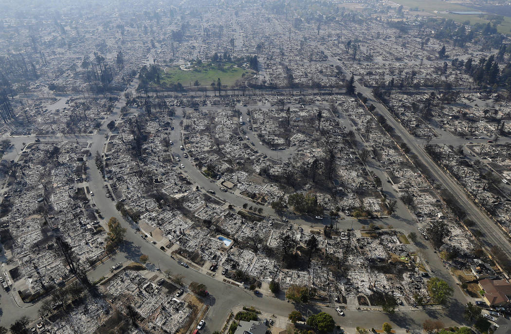 Homes burned by a wildfire are seen Wednesday, Oct. 11, 2017, in Santa Rosa, Calif. Wildfires whipped by powerful winds swept through Northern California sending residents on a headlong flight to  ...