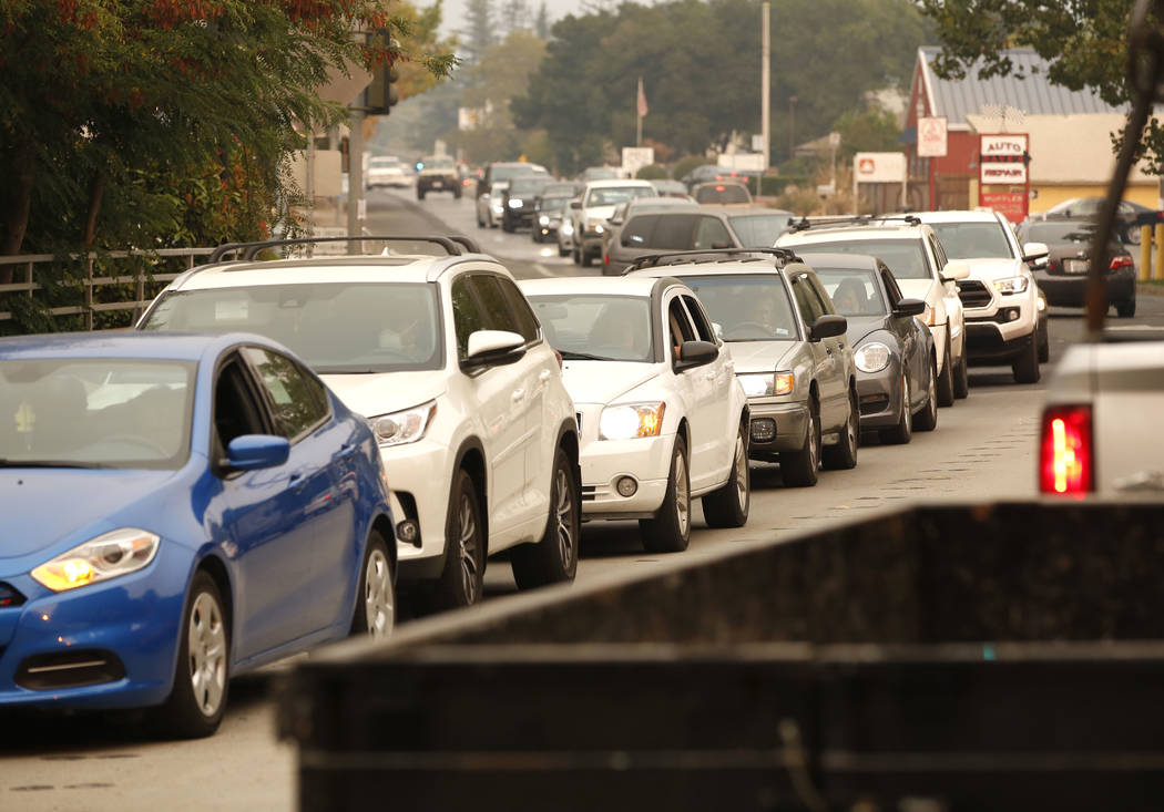 Cars crowd the streets as residents evacuate Sonoma, Calif, Wednesday, Oct. 11, 2017. With fires getting near, the town was placed under a voluntary evacuation order.(AP Photo/Rich Pedroncelli)