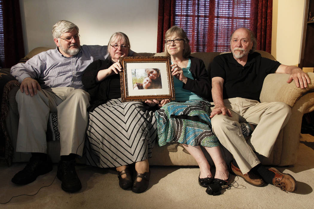 From left, Patrick Boyle, Linda Boyle, Lyn Coleman and Jim Coleman hold photo of their kidnapped children, Joshua Boyle and Caitlan Coleman, on June 4, 2014.  (AP Photo/Bill Gorman, File)