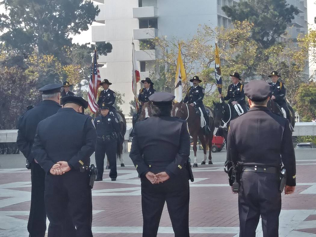 San Francisco police officers line up,  Thursday, Oct. 12, 2017, outside St. Mary's Cathedral in San Francisco after the funeral Mass for Stacee Etcheber. Etcheber was one of the 58 victims of the ...