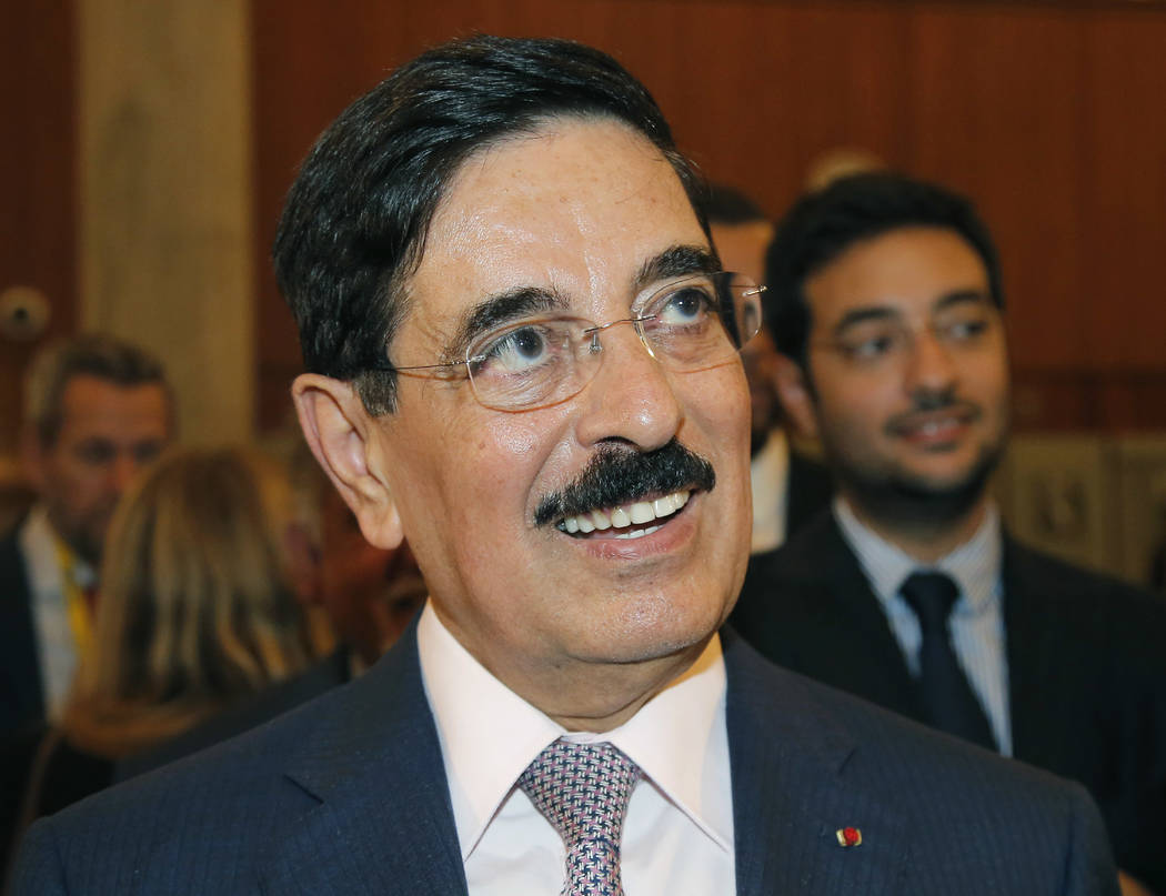 Hamad bin Abdulaziz al-Kawari, Qatar's candidate for the election of the United Nations Educational Scientific and Cultural Organization new leader, smiles at UNESCO headquarters in Paris, France, ...