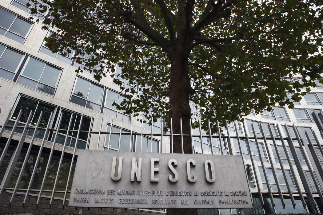 The United Nations Educational Scientific and Cultural Organization logo at the entrance at UNESCO's headquarters in Paris, Monday Oct. 17, 2016. U.S. officials have told The Associated Press that ...