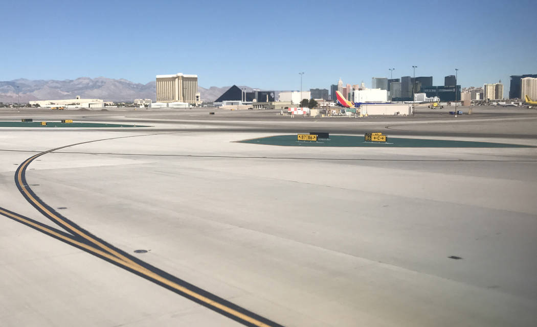 Mandalay Bay hotel-casino, left, from McCarran International Airport runways in Las Vegas on Monday, Oct. 2, 2017, one day after a gunman killed 58 people from his Mandalay Bay room. Heidi Fang La ...