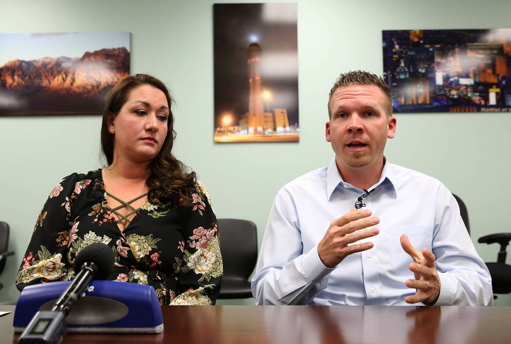 Las Vegas Tower air traffic controller Anthony Borgert speaks as air traffic controller Christina Stewart looks on as they speak to the media about what they experienced during the Las Vegas mass  ...