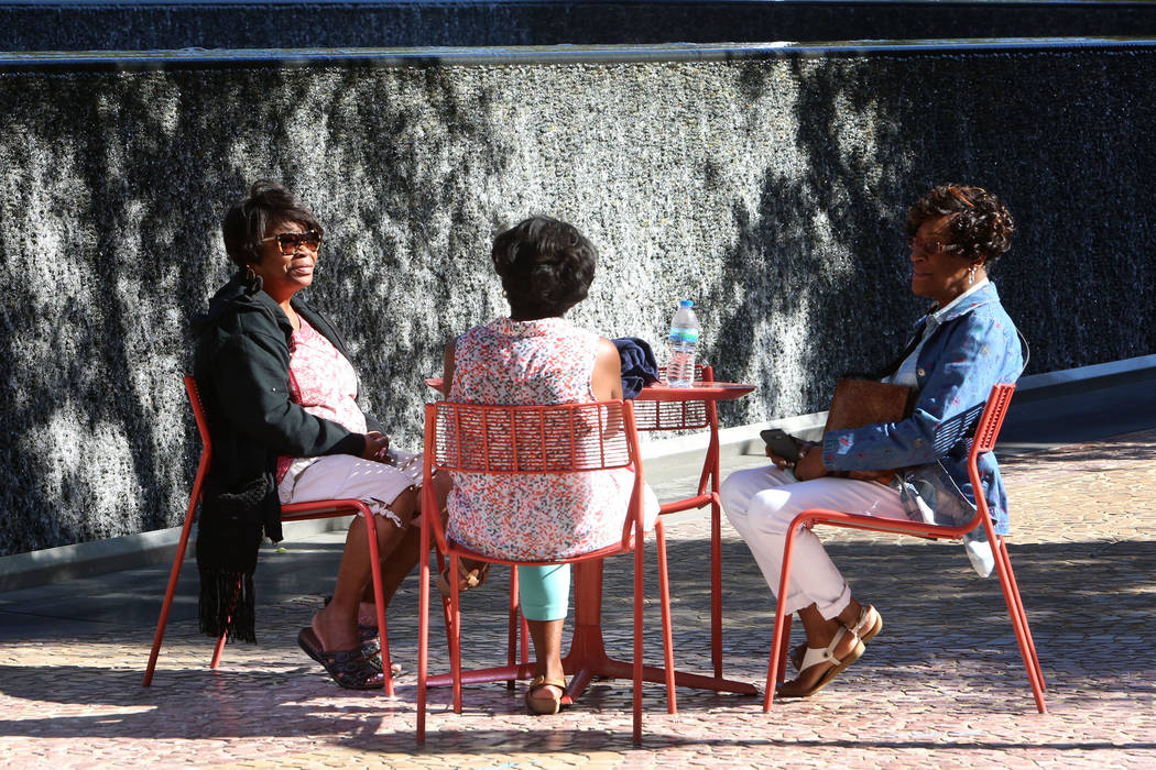 Priscilla Howell, center, Betty Jackson, right and a woman, left, who declined to give her name, all of Atlanta, relax at The Park near T-Mobile Arena on Thursday, Sept. 28, 2017, in Las Vegas. Bi ...