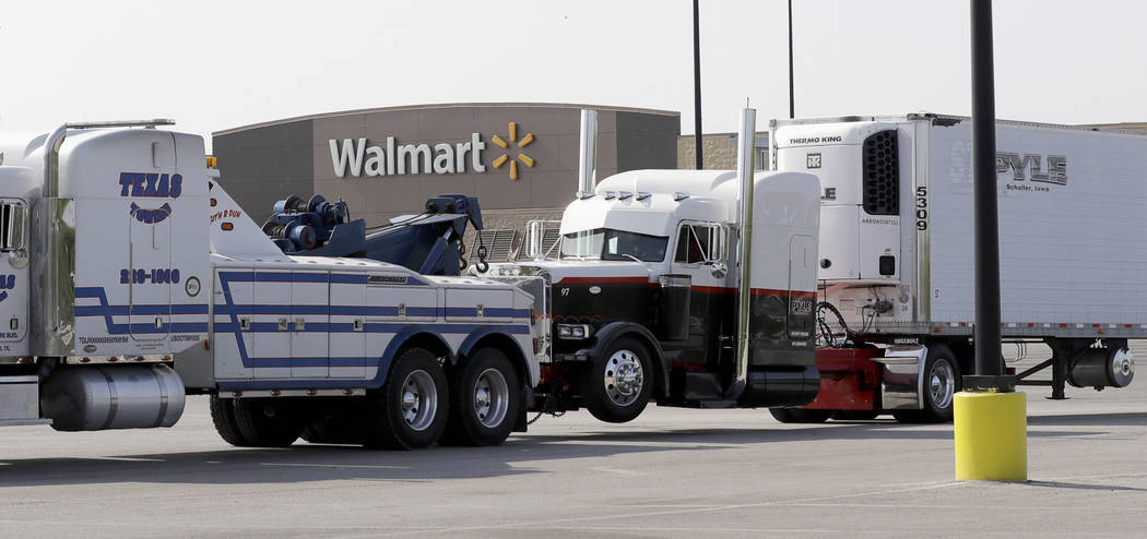 A Pyle Transportation-branded semitrailer, at right, is towed from the scene of a human trafficking July 23, 2017, case in which multiple immigrants died in San Antonio. Federal safety regulators  ...
