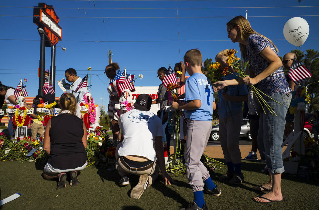 "People visit a makeshift memorial for victims of the mass shooting near the ""Welcome to Fabulous Las Vegas"" sign in Las Vegas on Saturday, Oct. 7, 2017. Chase Stevens Las Vegas Review-Journal @css ..."