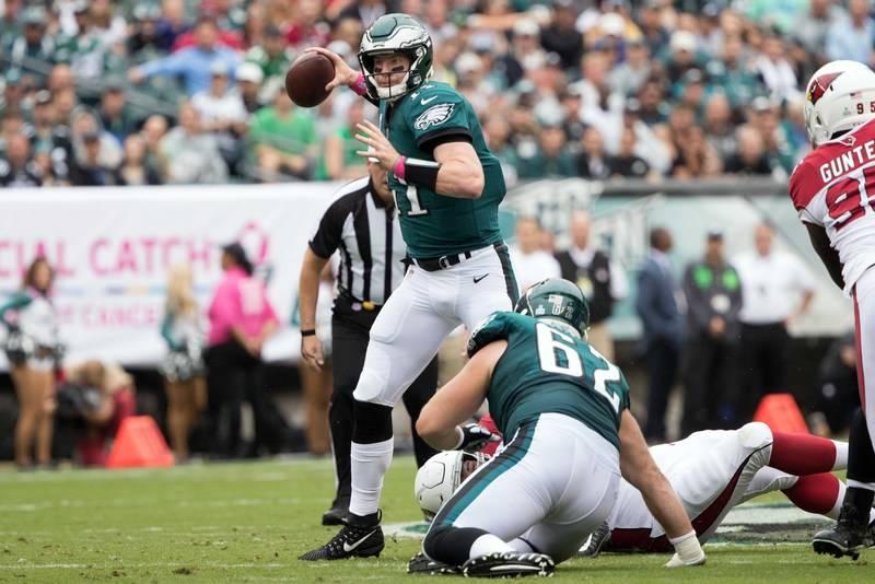 Oct 8, 2017; Philadelphia, PA, USA; Philadelphia Eagles quarterback Carson Wentz (11) passes against the Arizona Cardinals during the first quarter at Lincoln Financial Field. Mandatory Credit: Bi ...