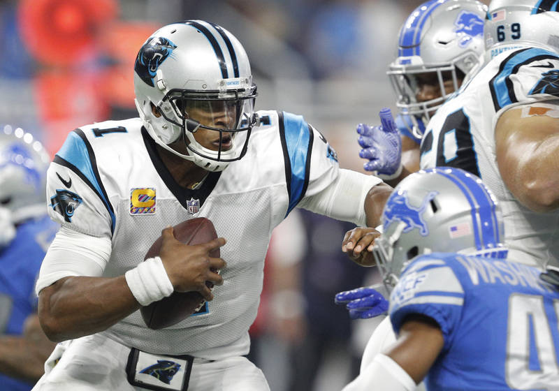 Oct 8, 2017; Detroit, MI, USA; Carolina Panthers quarterback Cam Newton (1) prepares to get sacked during the second quarter against the Carolina Panthers at Ford Field. Mandatory Credit: Raj Meht ...