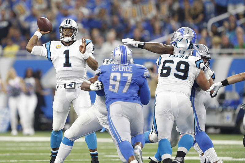 Oct 8, 2017; Detroit, MI, USA; Carolina Panthers quarterback Cam Newton (1) throws the ball as Detroit Lions defensive end Akeem Spence (97) pressures during the second quarter at Ford Field. Mand ...