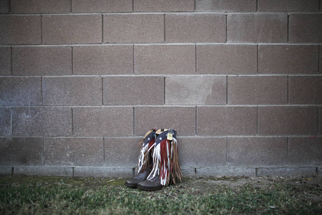 Kimbur Presmyk's boots she bought at the Route 91 Harvest Festival at her home in Las Vegas, Thursday, Oct. 12, 2017. Presmyk attended the festival when the mass shooting occurred. Her and her boy ...