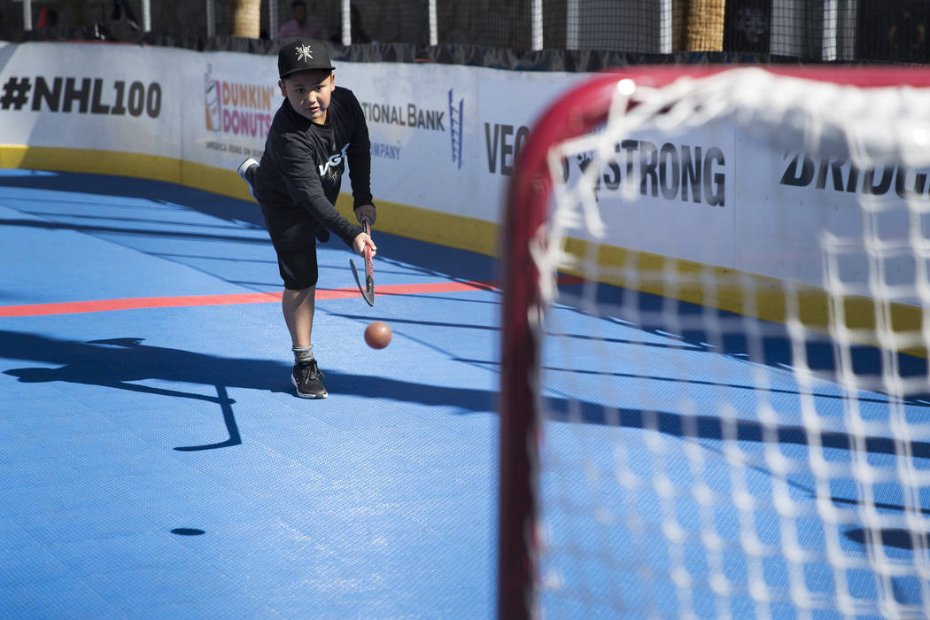 Kekoa Olegario, 9, in the NHL Centennial Fan Arena at the Fremont Street Experience in Las Vegas, Saturday, Oct. 14, 2017. Erik Verduzco Las Vegas Review-Journal @Erik_Verduzco