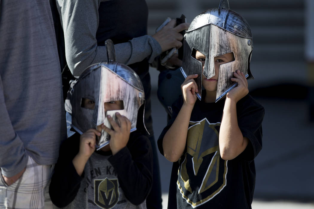 Niko Valentini, left, 4, and his brother Ben, 6, of Las Vegas, wait in line to Vegas Golden Knights player autographs in the NHL Centennial Fan Arena at the Fremont Street Experience in Las Vegas, ...