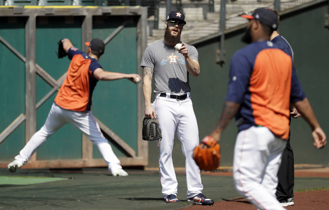 Houston Astros starting pitcher Dallas Keuchel warms up during practice Wednesday, Oct. 11, 2017, in Houston. The Astros beat the Red Sox to advance to the ALCS which is set to begin Friday. (AP P ...