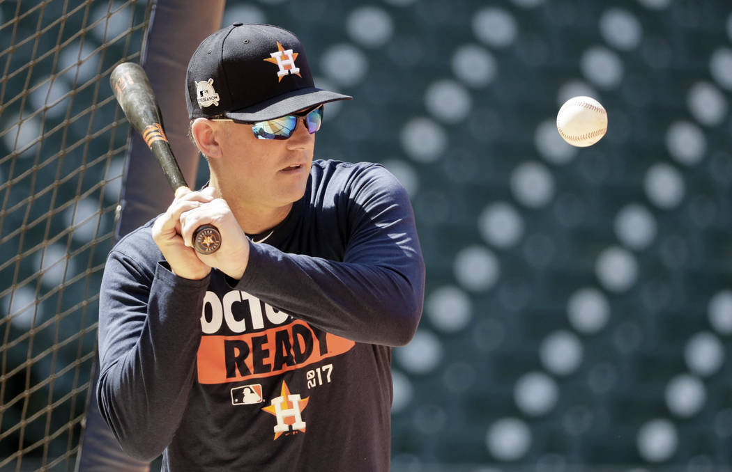Houston Astros manager A.J. Hinch hits ground ball to infielders during practice Wednesday, Oct. 11, 2017, in Houston. The Astros beat the Red Sox to advance to the ALCS which is set to begin Frid ...