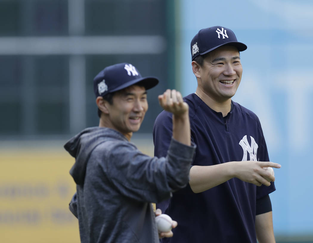 New York Yankees' Masahiro Tanaka smiles during batting practice for Game 1 of the American League Championship Series against the Houston Astros baseball game Thursday, Oct. 12, 2017, in Houston. ...