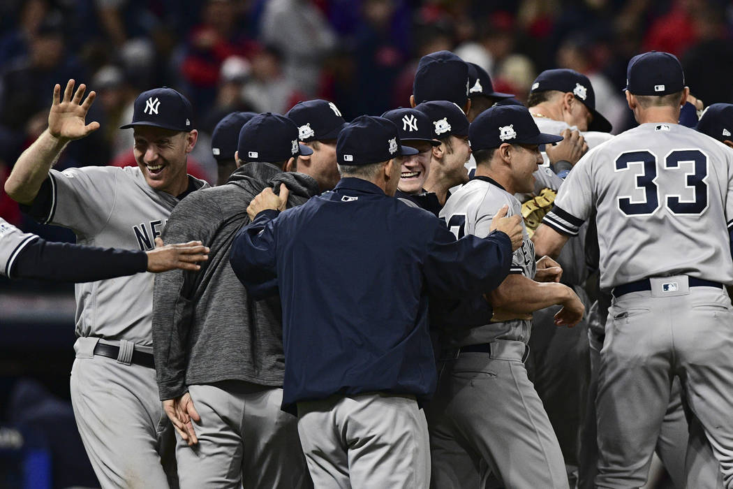 New York Yankees celebrate after the Yankees defeated the Cleveland Indians 5-2 in Game 5 of s baseball American League Division Series, Wednesday, Oct. 11, 2017, in Cleveland, to advance to the A ...