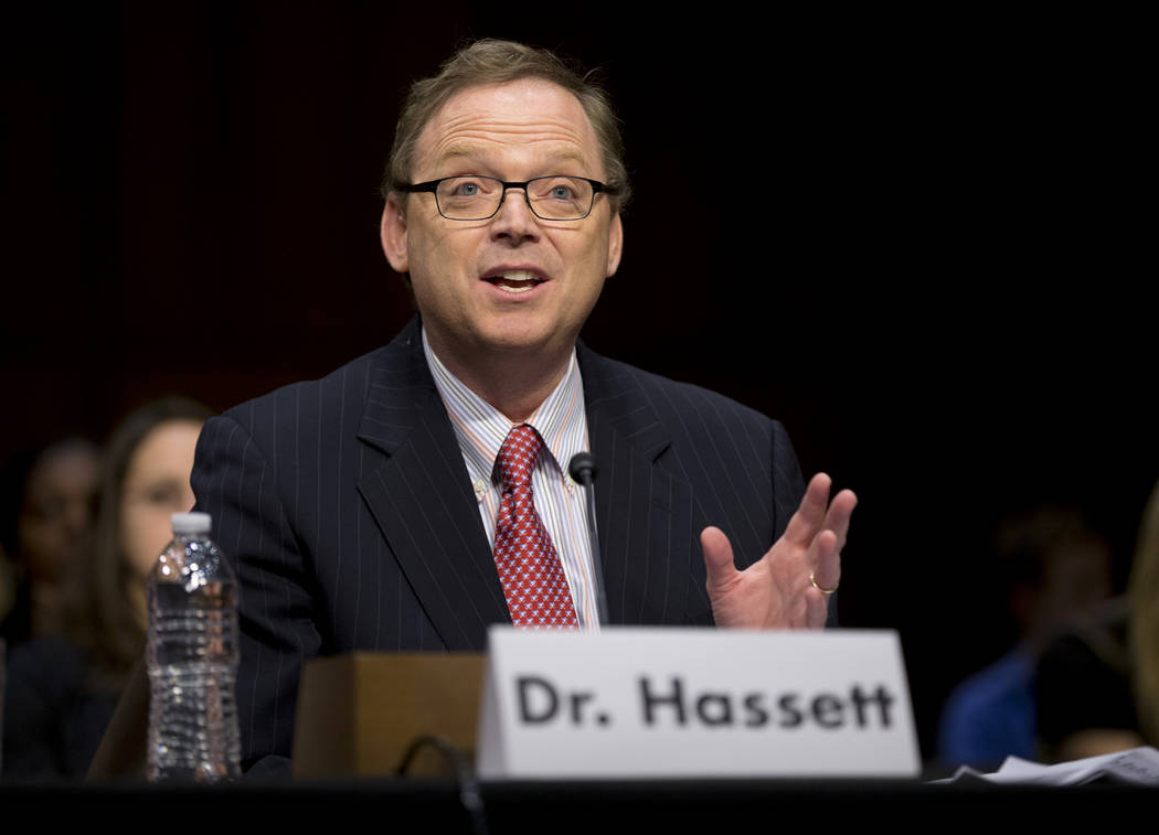In this Dec. 6, 2012, file photo, Kevin Hassett, senior fellow and director of Economic Policy at the American Enterprise Institute (AEI), gestures as he testifies on Capitol Hill in Washington be ...