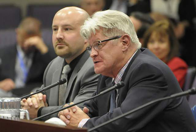 State Controller Ron Knecht, right, presents an alternative tax plan to Gov. Brian Sandoval's plan during a budget hearing Thursday, May 14, 2015, inside the Nevada Legislative Building in Carson  ...