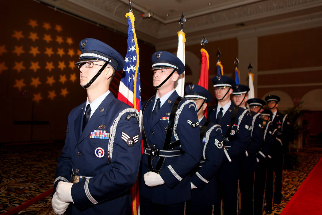 "United States Air Force Honor Guard stands by a red carpet to welcome in ""wounded warriors,"" to the MGM Resorts International annual ""Salute to the Troops"" event at The Mirage hotel-casino in Las  ..."