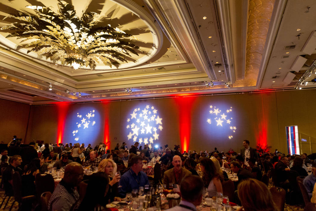 "Dinner is served during the MGM Resorts International annual ""Salute to the Troops"" event for ""wounded warriors,"" at the Mirage hotel-casino in Las Vegas, Oct.  ..."