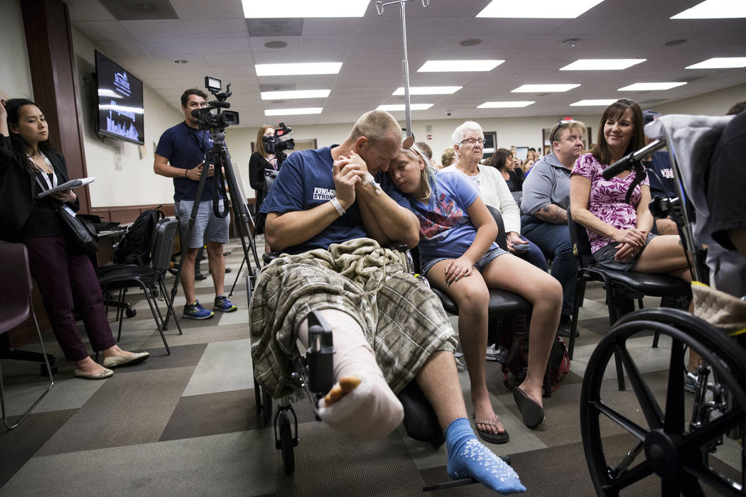 Kurt Fowler with his daughter Timori, 10, of Lake Havasu City, Ariz., at Sunrise Hospital during a music concert for patients and staff at the hospital auditorium in Las Vegas, Wednesday, Oct. 11, ...