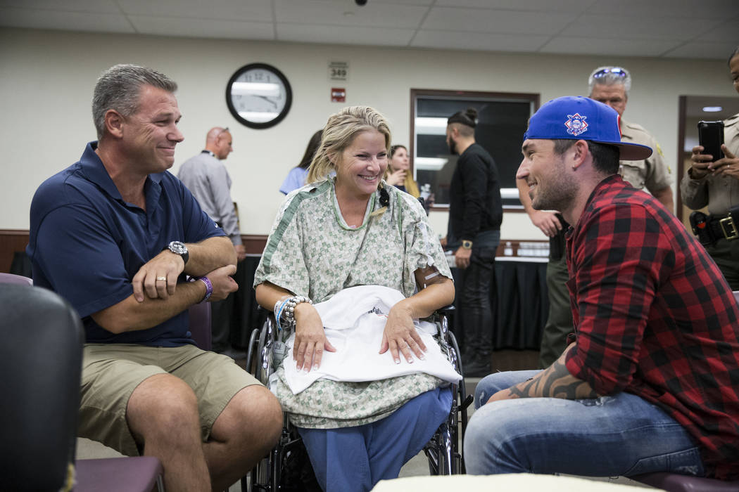 Todd Kammer, from left, and his wife Lori of Orange County, Calif., speak with music artist Michael Ray at Sunrise Hospital following a music concert for patients and staff at the hospital auditor ...