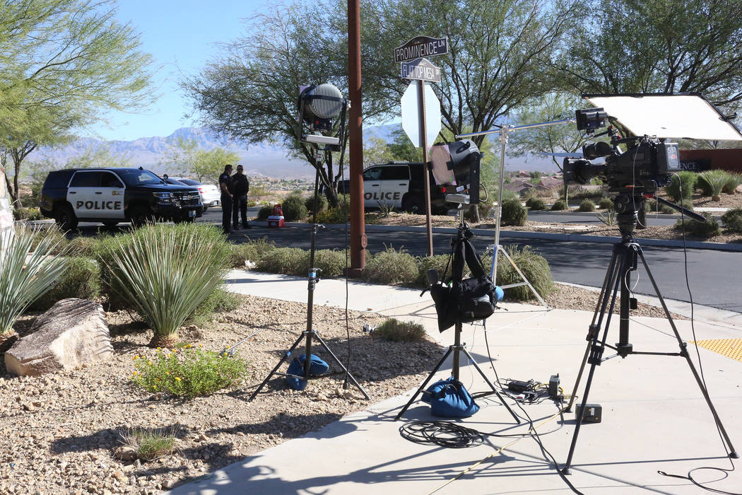Media waits outside the police barricade to the Prominence sub-division in Sun City Mesquite while inside the residence of Route 91 massacre shooter Stephen Paddock is investigated on Monday, Oct. ...