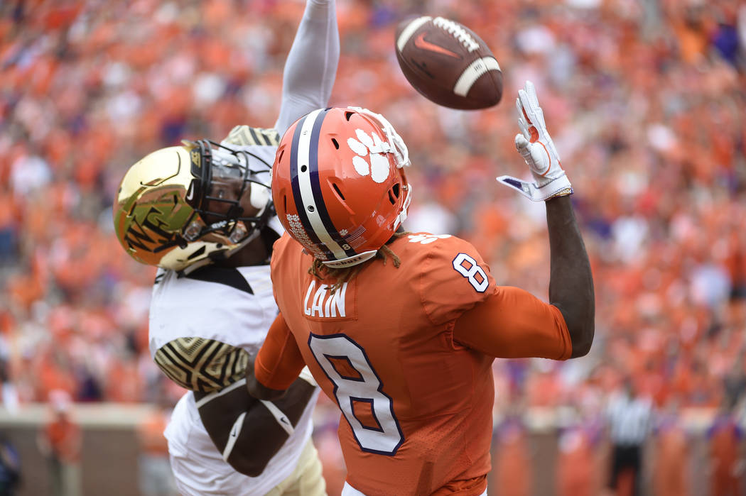Clemson wide receiver Deon Cain (8) goes for a catch over a Wake Forest defender during the first half of an NCAA college football game, Saturday, Oct. 7, 2017, in Clemson, S.C. The pass was incom ...