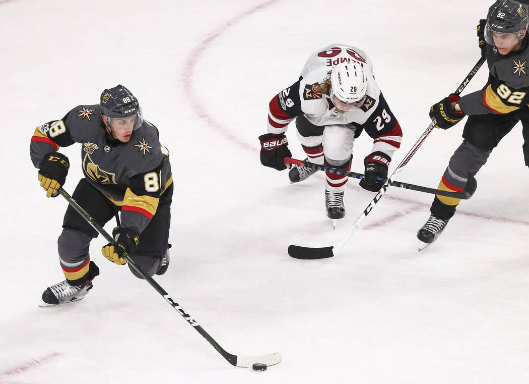 Vegas Golden Knights defenseman Nate Schmidt (88) controls the puck during the third period of an NHL hockey game between the Vegas Golden Knights and the Arizona Coyotes, Tuesday, Oct. 10, 2017,  ...