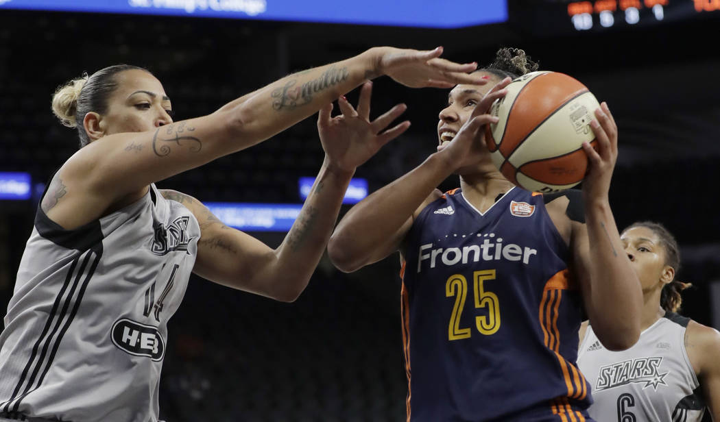 Connecticut Sun forward Alyssa Thomas (25) is defended by San Antonio Stars forward Erika de Souza (14) as she tries to score during the first half of a WNBA basketball game, Wednesday, July 5, 20 ...