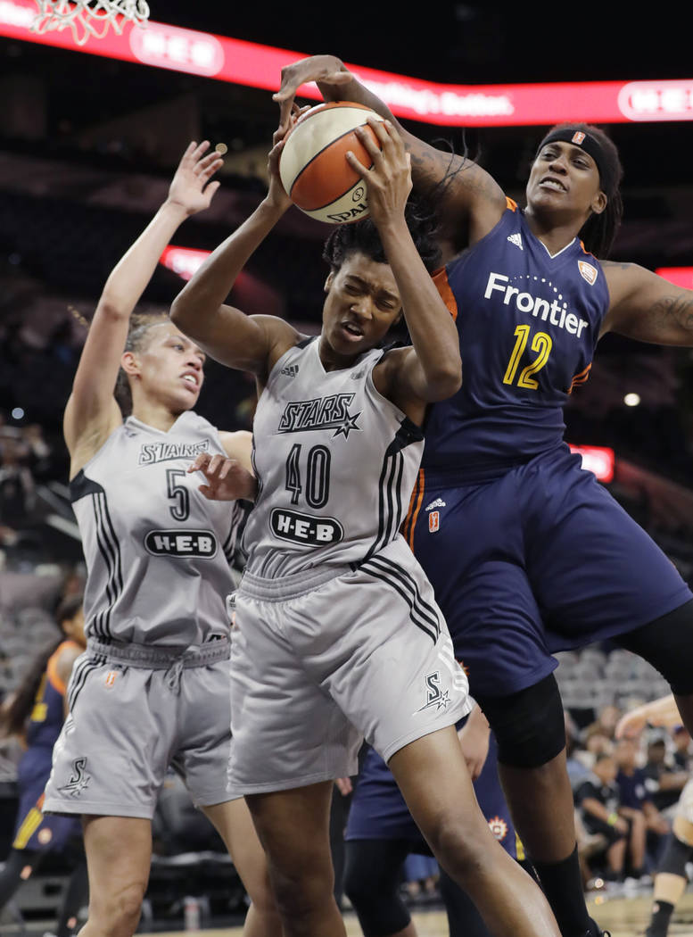 San Antonio Stars center Kayla Alexander (40) is blocked by Connecticut Sun center Lynetta Kizer (12) during the second half of a WNBA basketball game, Wednesday, July 5, 2017, in San Antonio. Con ...