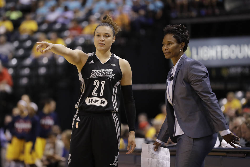 San Antonio Stars' Kayla McBride talks with head coach Vickie Johnson during the second half of a WNBA basketball game against the Indiana Fever, Wednesday, July 12, 2017, in Indianapolis. San Ant ...