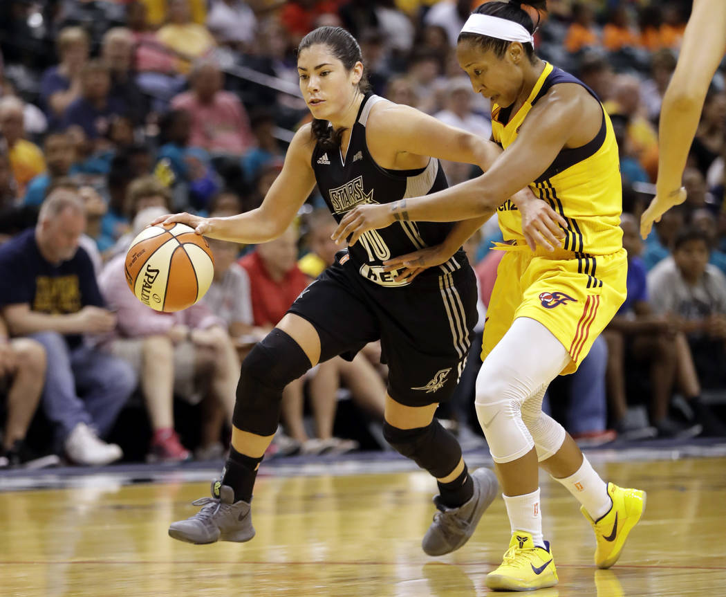 FILE - In this July 12, 2017, file photo, San Antonio Stars' Kelsey Plum, left, goes toward the basket against Indiana Fever's Briann January during the first half of a WNBA basketball game in Ind ...