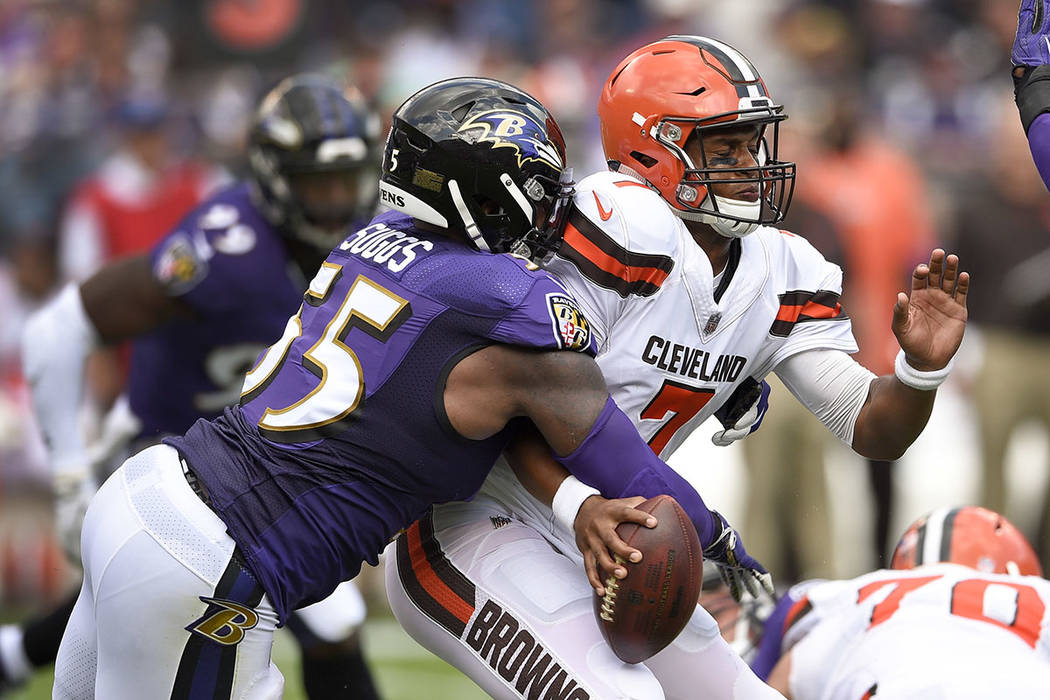 Baltimore Ravens outside linebacker Terrell Suggs (55) strips the ball from Cleveland Browns quarterback DeShone Kizer (7) forcing a turnover during the first half in Baltimore, Sunday, Sept. 17,  ...