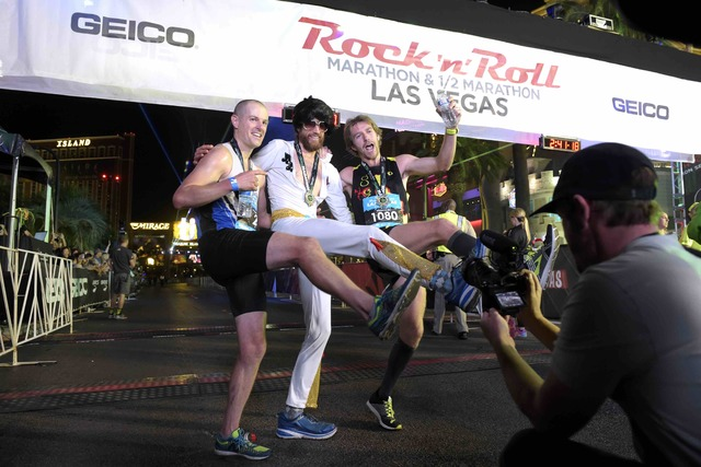 Third-place finisher Chip O'Hara, winner Mike Wardian and second-place finisher Eric Fitzpatrick celebrate during the Geico Las Vegas Rock 'n' Roll Marathon on Sunday, Nov. 13, 2016, on the Las Ve ...