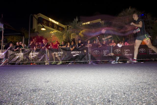 Spectators watch the annual Rock 'n' Roll Marathon at the Strip near The Mirage hotel-casino on Sunday, Nov. 13, 2016, in Las Vegas. Erik Verduzco/Las Vegas Review-Journal Follow @Er ...