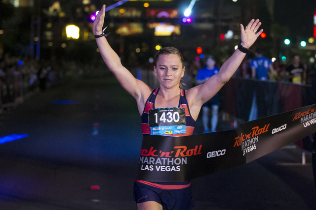 Elaina Schellhaass completes the Rock-n-Roll Marathon in first place for women at the Strip near The Mirage hotel-casino on Sunday, Nov. 13, 2016, in Las Vegas. Erik Verduzco/Las Vegas Review-Jour ...