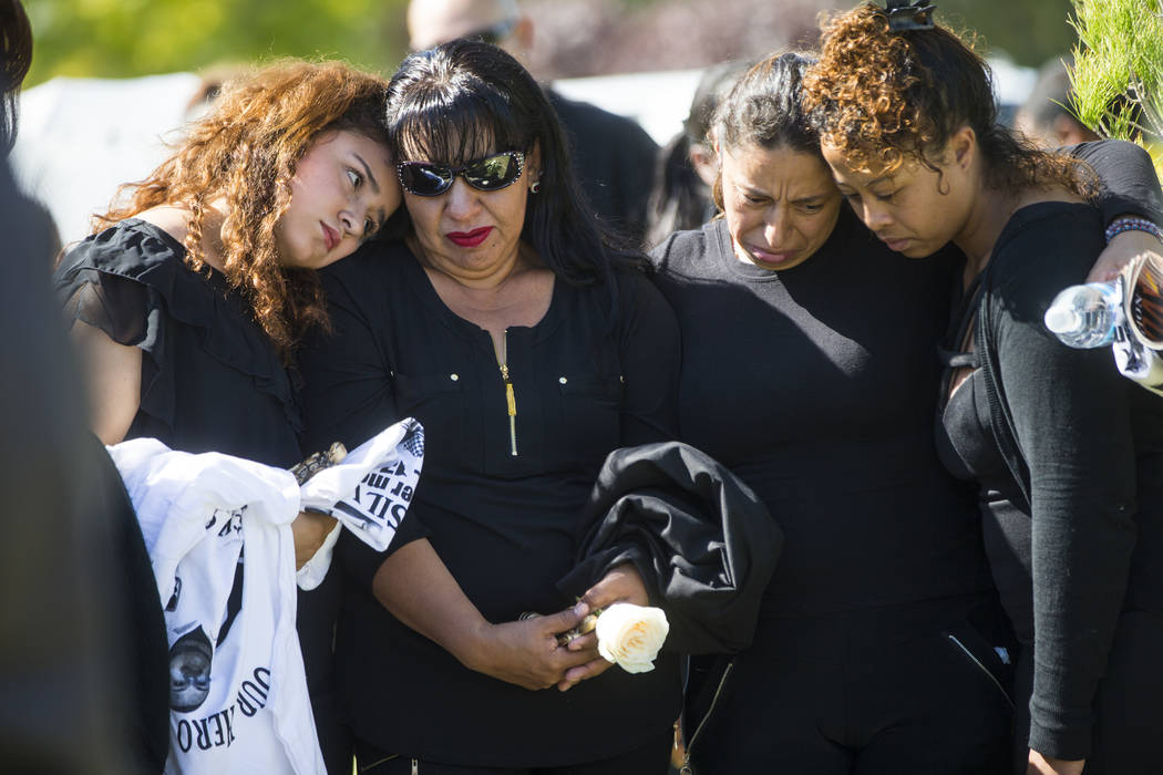 Sixteen-year-old Chantal Sosa, left, comforts her mother Angelica Cervantes during funeral services for Erick Silva at Davis Funeral Home & Memorial Park in Las Vegas on Thursday, Oct. 12, 201 ...