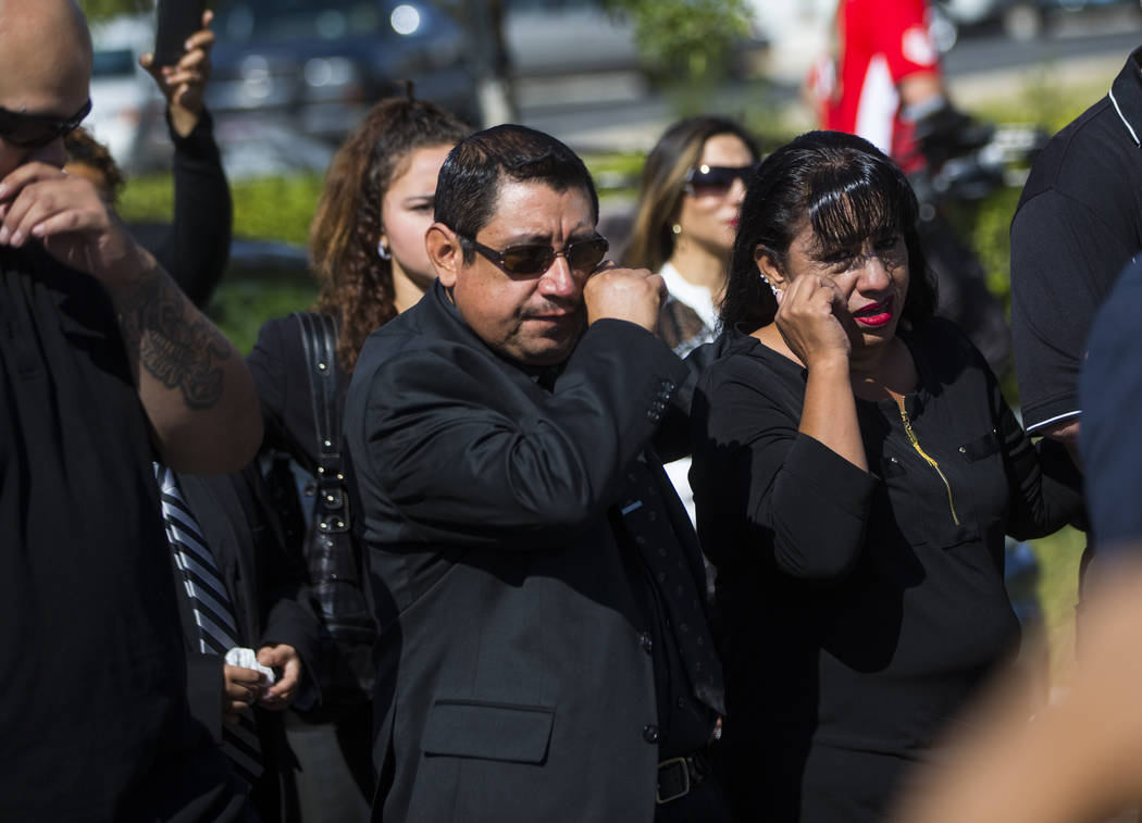 Gregorio De La Rosa, left, and Angelica Cervantes, mother of Erick Silva, follow the casket of Silva during funeral services at Davis Funeral Home & Memorial Park in Las Vegas on Thursday, Oct ...