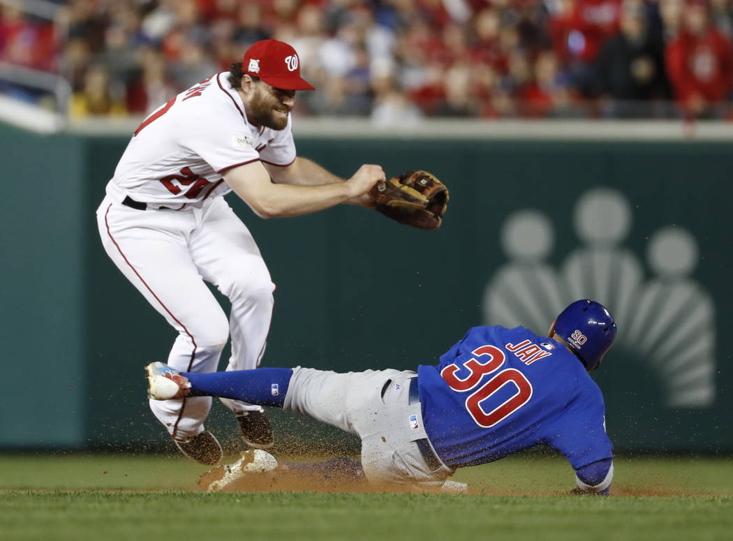 Washington Nationals second baseman Daniel Murphy (20) jumps after forcing out Chicago Cub's Jon Jay (30) on a ball hit by Kris Bryant, who was safe at first during seventh the inning of Game 5 of ...