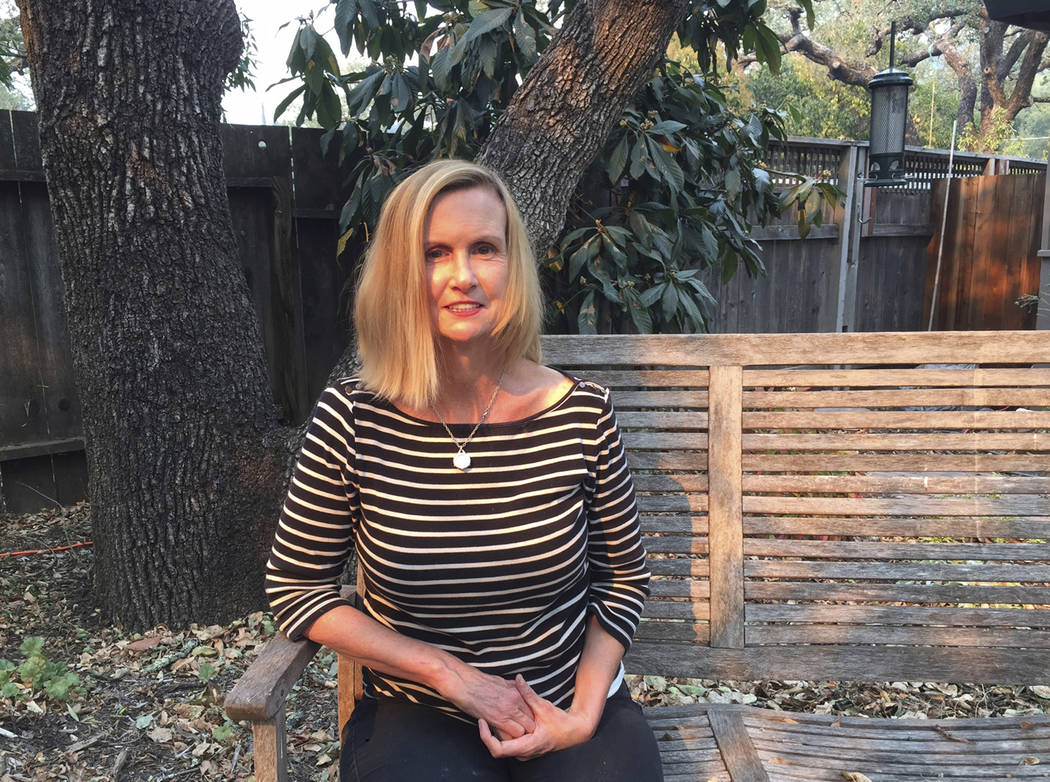 Associated Press reporter Ellen Knickmeyer poses for a photo at her home in Boyes Hot Springs, Calif., Thursday, Oct. 12, 2017. Knickmeyer wrote on life in communities under threat from California ...