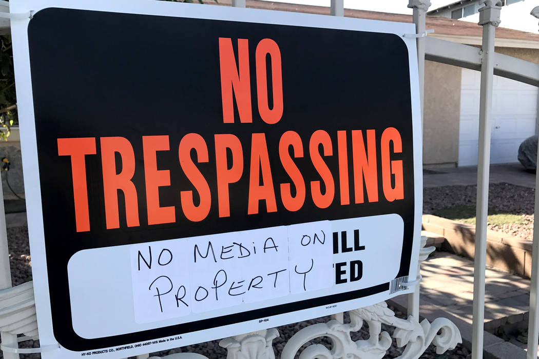 A sign warning members of the news media not to enter Jesus Campos' home in east Las Vegas hangs on a gate on Friday, Oct. 13, 2017. Sandy Lopez Las Vegas Review-Journal